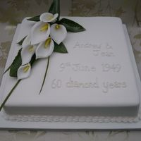 Diamond Anniversary Cake With Callas This cake was a scratch sponge cake with jam & vanilla buttercream. My first time making Calla Lillies and I'm happy with the...