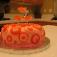 Pink Champagne Cake Covered with fondant and wine glass favors on the top with rock candy