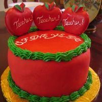 Teacher Of The Year fondant covered with chocolate lollie pops