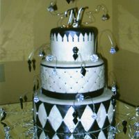 Jeweled Wedding Cake White chocolate cake covered in black and white MMF and brushed with super pearl dust. This cake was designed by the bride.....I wasn'...