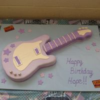 Hope's Guitar Cake This cake was for my daughter's 6th birthday which was a 'Camp Rock' theme. White cake covered in MMF w/ gumpaste accents....