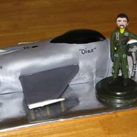 F-16 Plane And Pilot This was for a 40th birthday. Plane is made of cake covered with fondant. Wings are cardboard covered in fondant. My fist time sculpting...
