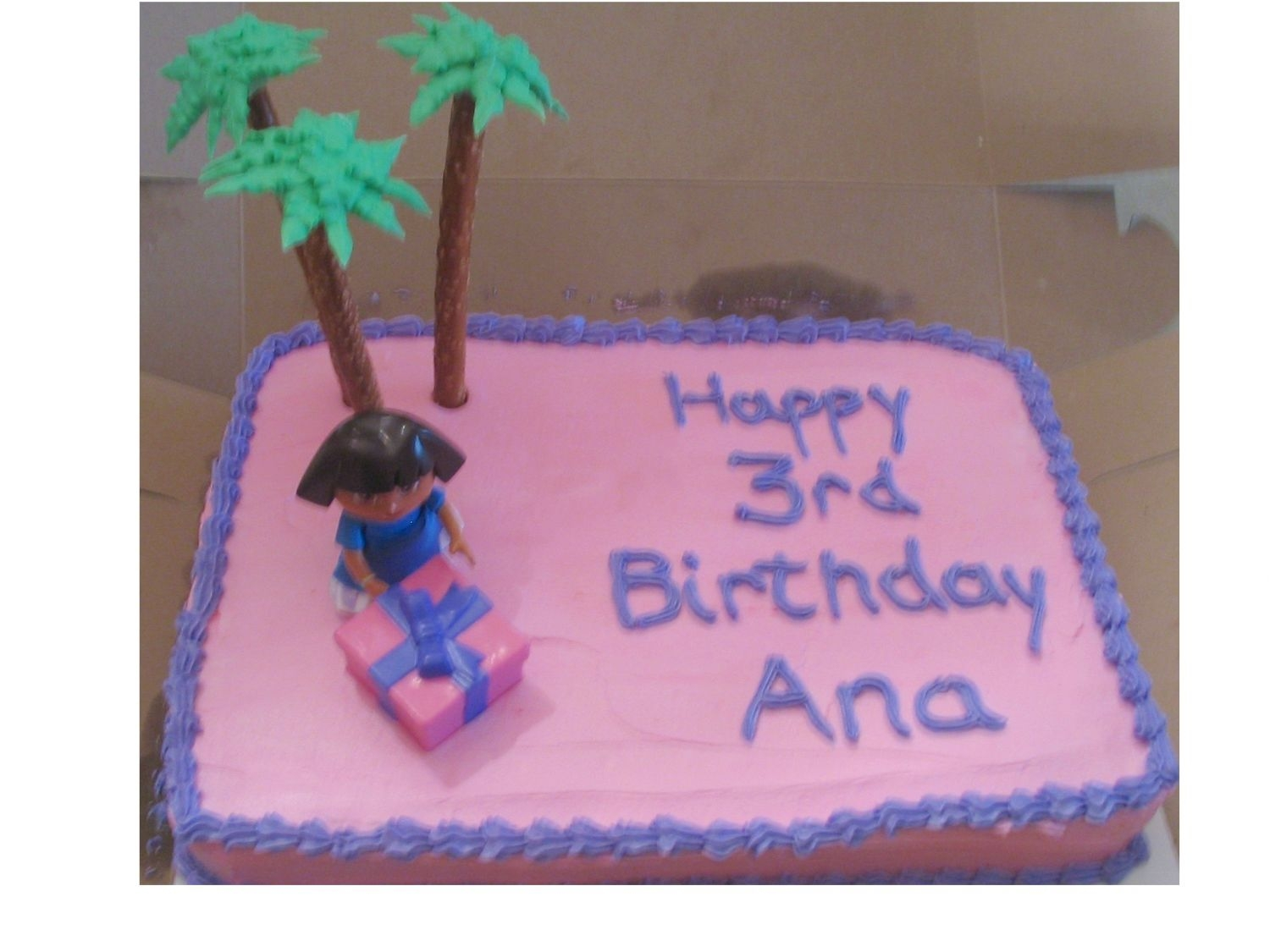 Dora Birthday Cake   Chocolate cake with buttercream frosting. Palm trees made of pretzel rods & buttercream leaves.