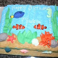 Aquarium Cake Aquarium themed cake for my daughter's birthday. I used fondant to make the fish and other sea creatures, shells, rocks and plants. I...