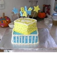 Yellow And Blue Baby Shower Two tiered yellow cake with buttercream frosting
