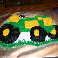 John Deere Tractor I used the Wilton Tractor Pan and Buttercream frosting. Not my best effort but my 2 year old son loved it!!