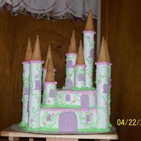 Princess Castle  I took a couple ideas from the awesome site and put them together to make my first cake for someone outside of my family. I made this for a...