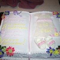 100_1059.jpg  This is a cake my third cake i've made..it is made with the wilton two mix book pan. done with bc icing silk flowers and the dress and...