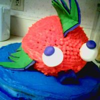 Fish Cake   Round sports ball pan and 12 inch pan. Eyes are made of fondant but marshmellows could be subsituted