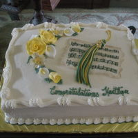 Graduation buttercream with rice paper music and gumpaste flowers