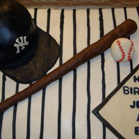 Yankee's Baseball Cake Sheet cake covered in buttercream. Stripes are royal icing. Hat is covered in MMF, Bat is made of modeling chocolate, Ball is MMF, home...