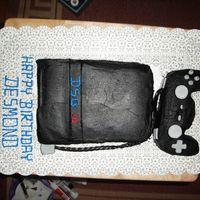First Attempt At Sony Ps2 Cake I did my best to get it smooth, but the buttercream was driving me crazy! I wanted to use fondant but I could not get it black. Chocolate...