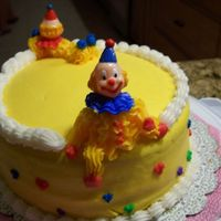Course 1 Clown Cake This clown's leg was propped up on the top of the cake.