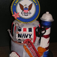 Navy Barbershop This cake was made for an 80th birthday. The man had been in the Navy and was also a barber, so they wanted a cake to showcase both. This...