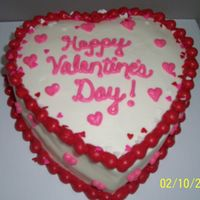 Heart Cake   2-layer heart cake. White cake, all bc icing