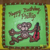 Guitar Monkey Cake   Made for my brother who plays guitar and collects monkeys