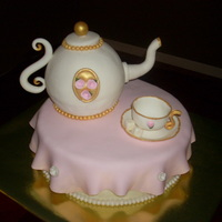Tea Party Cake Made for a very special mother/daughter tea party at my church. Fondant teapot and teacup. Teapot is lemon cake w/swiss merengue...