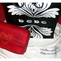 Bebe Bag And Wallet based on a photo of a bebe bag with a red wallet..