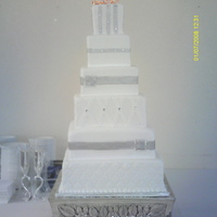 Square Wedding Cake   based on a design from tonedna.. I REALLY didn't do her justice.. inedible stones and buckles..