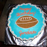 Football Birthday Cake   This was for a friend's grandboy. She loved it and I got paid for it. YEA!!!!!!2 layer yellow cake with buttercream.