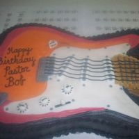 Pastor Bob's Guitar This was for my pastor's birthday. I tried to replicate his guitar he plays in church. I done the best I could. Almond cake with...