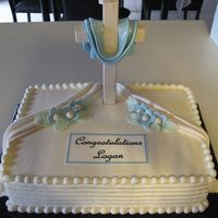 004_3.jpg Iced in Bc with wooden cross. fondant accents