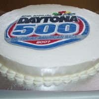 Daytona 500 Nascar Cake White Almond Sour Cream cake, IMBC, and cheesecake flavoured pudding with blackberries for the filling. Logo is done in FBCT. The best...