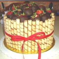 Sil Birthday Cake 3 Layers of Chocolate fudge cake, chocolate fudge icing and fresh strwberries, a layer of Ding Dong fiiling with fresh strawberries, iced...