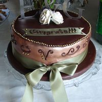 October_Engagement_2007_001A.jpg   Engagement Party Cake Chocolate fondant with chocolate & vanilla cake w/ raspberry filling The letters are metal monograms...