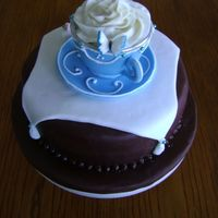 Blue Teacup Cake   A Blue Teacup a top of a chocolate fudge and raspberry filled cake