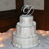 Wedding Cake This cake is covered in fondant and then decorated with fondant painted with pearl dust.