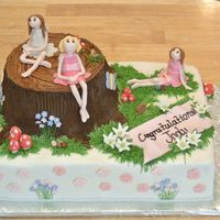 Fairy Cake This is a cake I made for a baby shower with a fairy theme. Thanks to JulesM7 for the tree stump idea and liis for the great fairy-making...