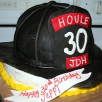Fire Helmet I made this from the tutorial on this site! It was marble cake buttercream and chocolate fondant. I used the wilton soccerball pan, and 2 9...