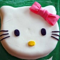 "Hello Kitty! Just a hello kitty face! Strawberry homemade cake, with Buttercream and MMF. Carved from a 10"" and 6"" (for ears)"