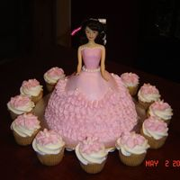 Pink Doll Buttercream doll cake with cupcakes. Thanks for looking.