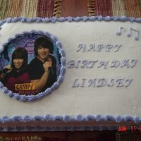 Camp Rock Birthday All BC Bday cake besides the party favor in the center.