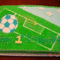 Soccer Birthday Birthday cake for my 1-year old nephew. The family is very involved with soccer but wanted it to look like it was for a little boy (blue...