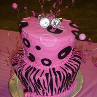 Diva Cake Pink and black with fondant zebra stripes and circles. Wire with fondant balls and dollar store rings