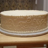 12 In Round Scrolling Yellow butter cake w/ BC. It's the third cake in the set for the wedding. The other 2 were 6 in swiss dots and 12 in square with...