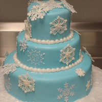 Snowflake Cake Light blue fondant with royal icing stenciled snowflakes on the fondant. The other snowflakes are hand-piped royal icing with edible...