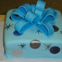 Blue Birthday Fondant bow and I painted the circles with silver, midnight blue and light blue luster dust and the little stars too. The bow cracked a...