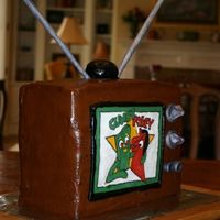 Tv, Pokey Gumby   chocolate and strawberry 6 layer cake with choco BC, color flow tv screen image and mmf accents
