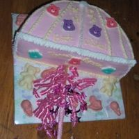Pink And White Carebear Umbrella Mother-to-be's chosen theme was Care Bears, with pink and white as the chosen colors. Cake was made in the shape of an umbrella, with...