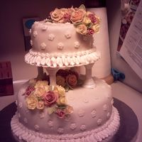 Course Iii Wedding Cake Chocolate Bottom tier, strawberry top tier. Fondant roses in peach, yellow and dusty rose.