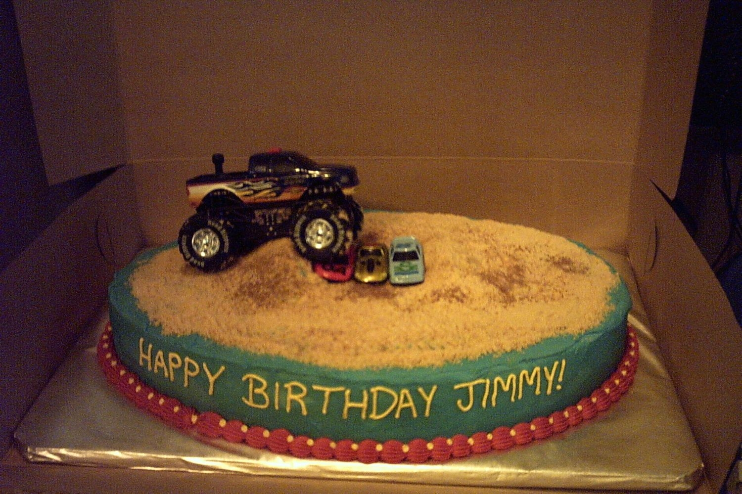 "Monster Truck Ralley Quick b-day cake for my nephew. Chocolate lover's cake w/ bc icing and toy truck and cars. Cookie crumb ""dirt"" highlighted w..."