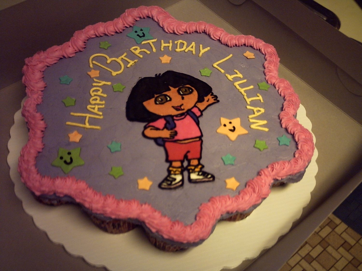 Dora Cupcake Cake First attempt on a cupcake cake made for my daughter's b-day at daycare. Dora was a FBCT.