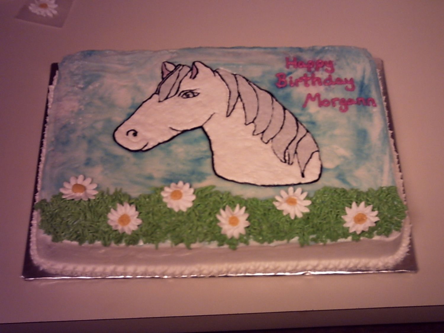 Horse Birthday Free hand horse head. Spice cake w/ bc icing and royal flowers