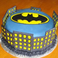 Batman/gotham City Cake Made this for a preteen boy who loves Batman! Chocolate cake covered in fondant. Buildings and Batman symbol are royal icing transfers....