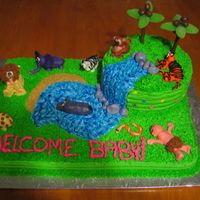 Jungle Themed Baby Shower Cake  Thanks to everyone on this site for the ideas for this cake!Vanilla sheet cake and chocolate 8inch round cake covered in BC icing. Animals...
