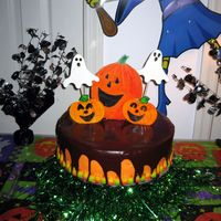 Spooky Cake I made this for my daughters' Halloween party - it is a devils food cake with buttercream and chocolate glaze. The large pumpkin is a...
